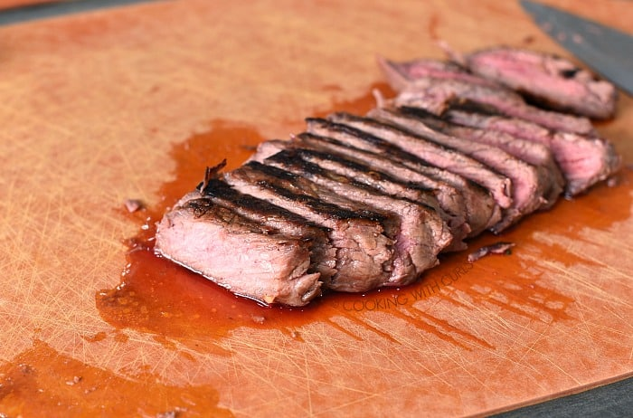 Thinly sliced steak on a cutting board cookingwithcurls.com