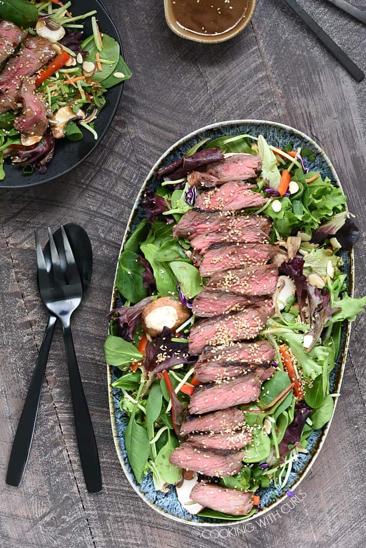 This Asian Steak Salad is loaded with flavor, cooked to perfection, easy to prepare and super healthy! cookingwithcurls.com
