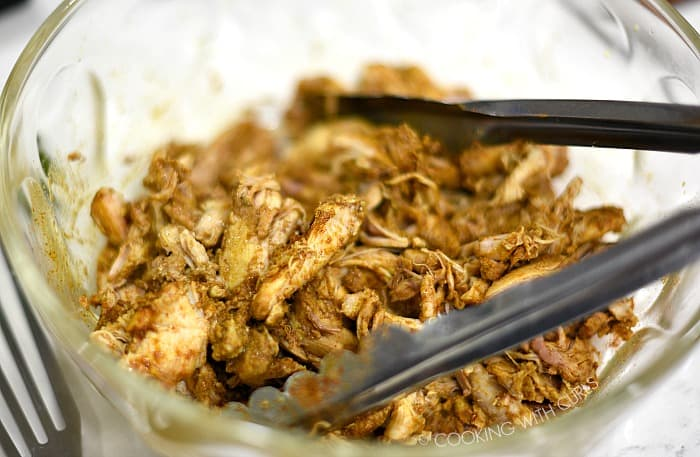 Toss the cooked chicken shawarma with the spices in a large bowl cookingwithcurls.com