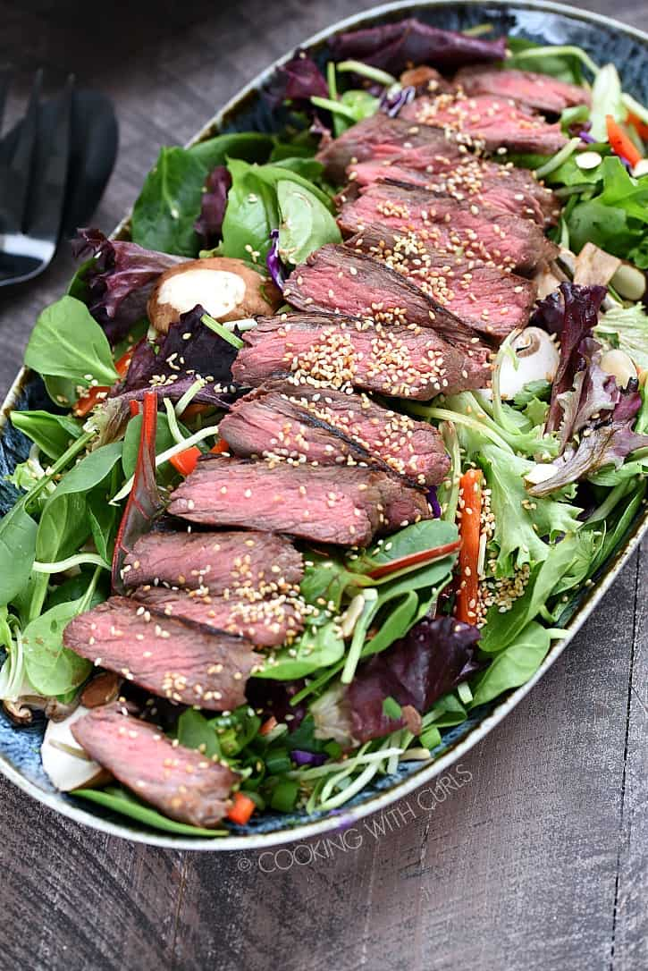 Your family will absolute love this Asian Beef Salad! Marinated sirloin is grilled to perfection, and the marinade becomes the dressing...so delicious! cookingwithcurls.com