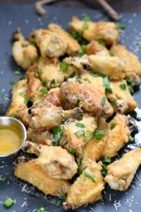 These Garlic Parmesan Chicken Wings are crazy simple to prepare and the flavor is amazing! cookingwithcurls.com