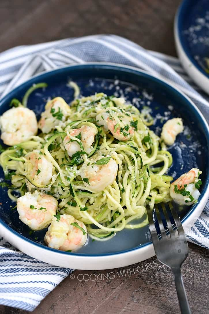 Zucchini Shrimp Scampi is made with zucchini noodles and garlic-lemon shrimp for a delicious Keto, gluten-free twist on an Italian favorite! cookingwithcurls.com