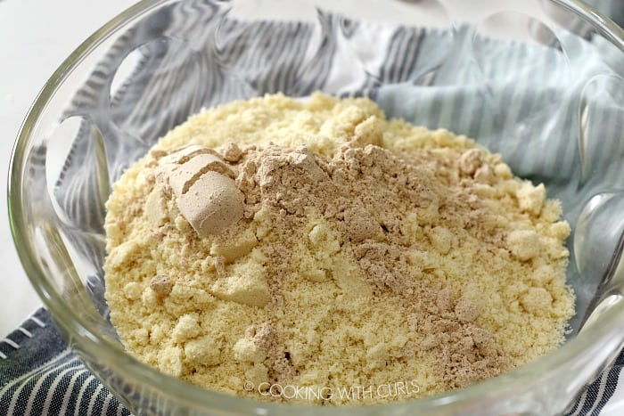 almond flour, protein powder, and seasonings in a large clear glass bowl