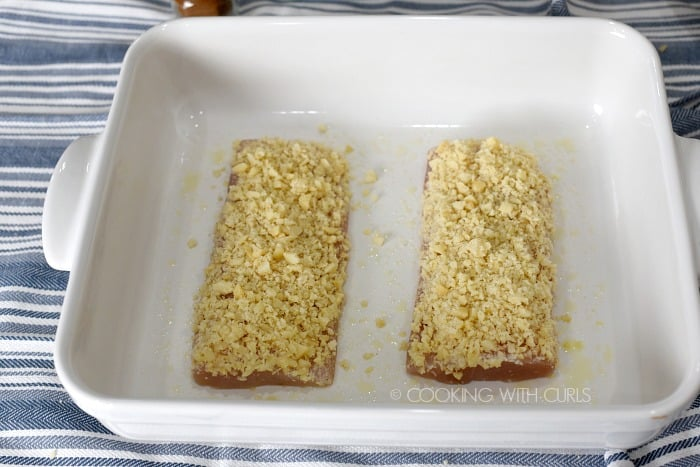 Macadamia nut crusted Mahi-Mahi in a white baking dish