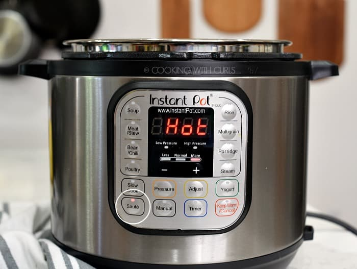 An Instant Pot set the Saute with HOT in bright red letters on the display