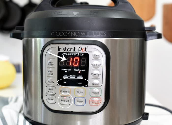 An Instant Pot with the Manual button selected and 10 minutes showing on the display