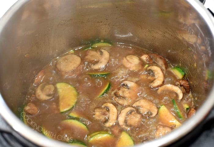 Chinese Garlic Chicken simmering in the metal liner of a pressure cooker