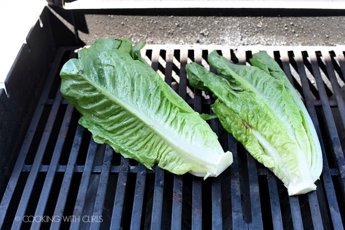 Romaine lettuce placed cut side down on a hot grill