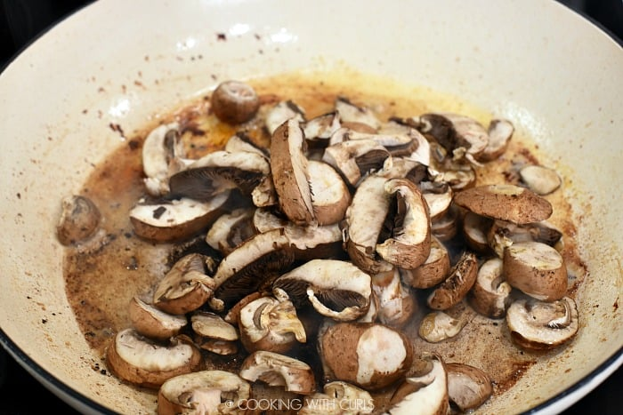 Shallots and mushrooms added to the hot skillet