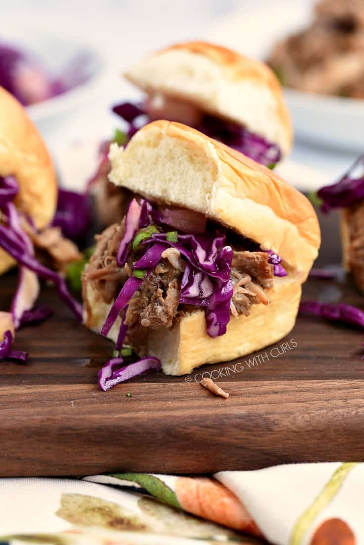 Hawaiian Pulled Pork sliders on a wooden serving board