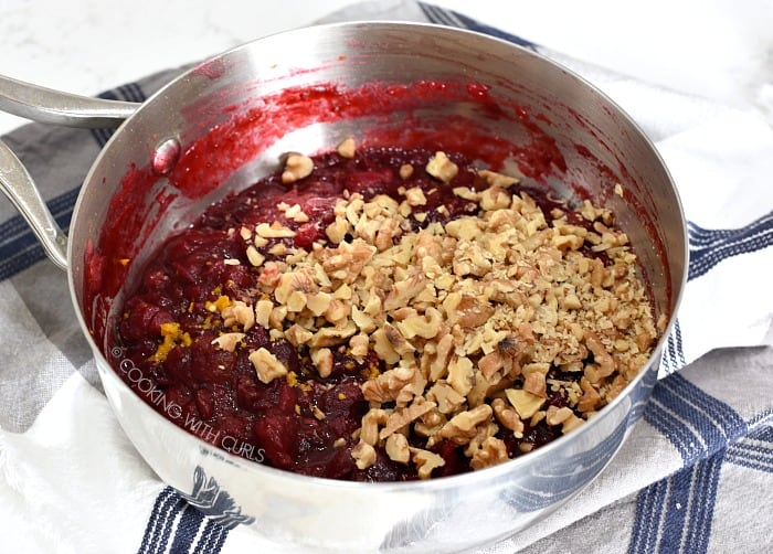 Chopped, toasted walnuts and orange zest added to the cooked cranberry sauce with pineapple