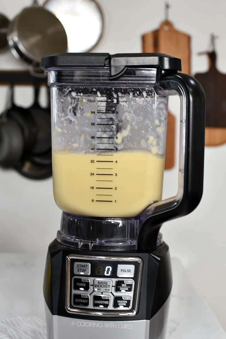 Mango Pina Colada Smoothie being blended in a blender