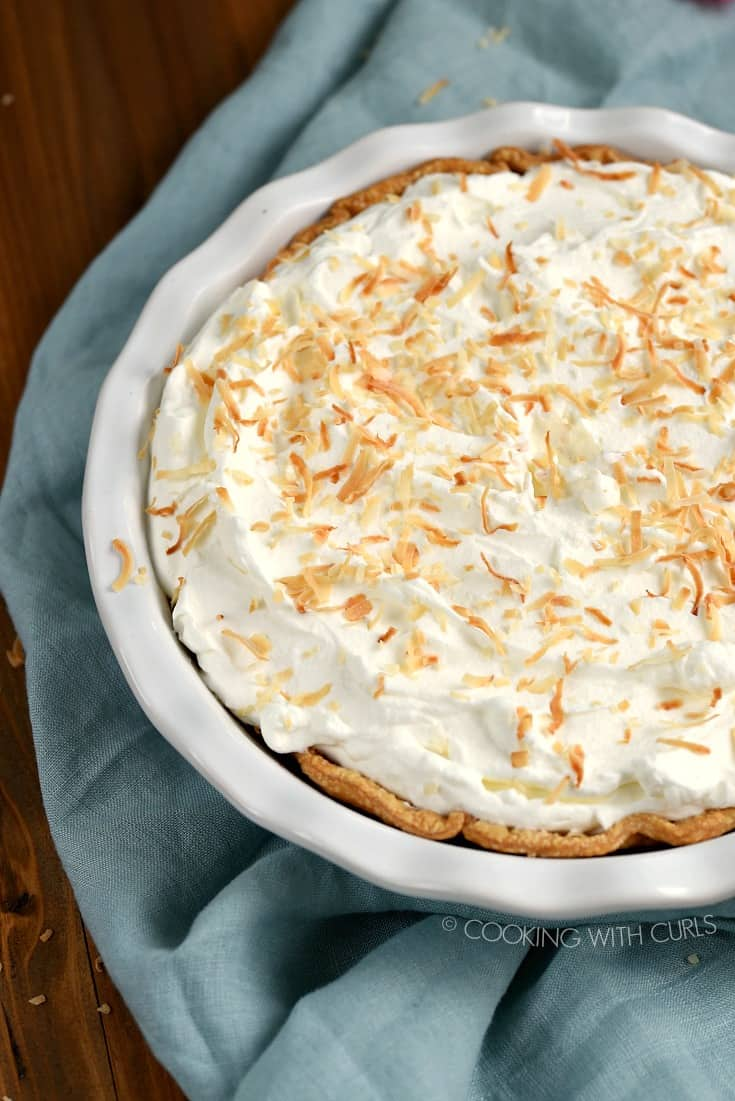 Looking down on a whole Pina Colada Pie topped with toasted coconut