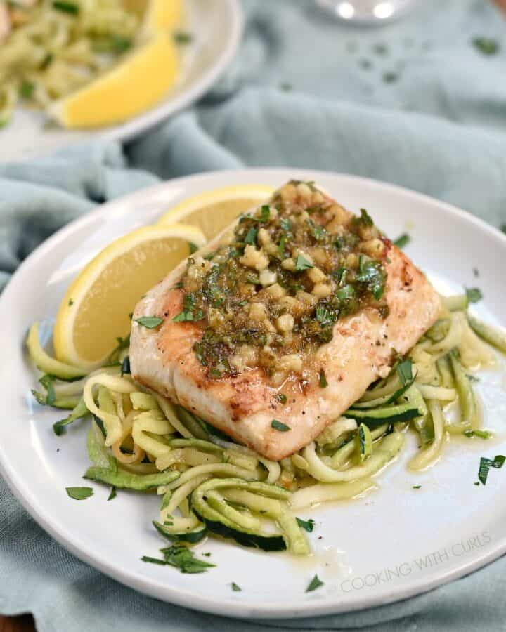 Lemon Garlic topped Mahi Mahi served on a bed of zucchini noodles
