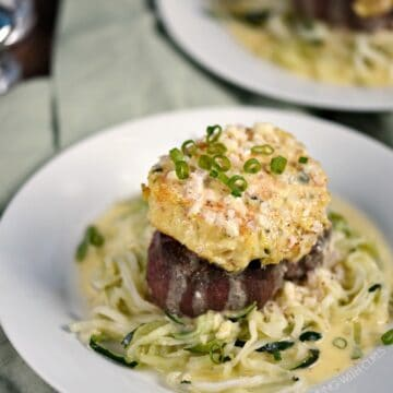 Crab Cake topped Filet Mignon on a bed of zucchini noodles