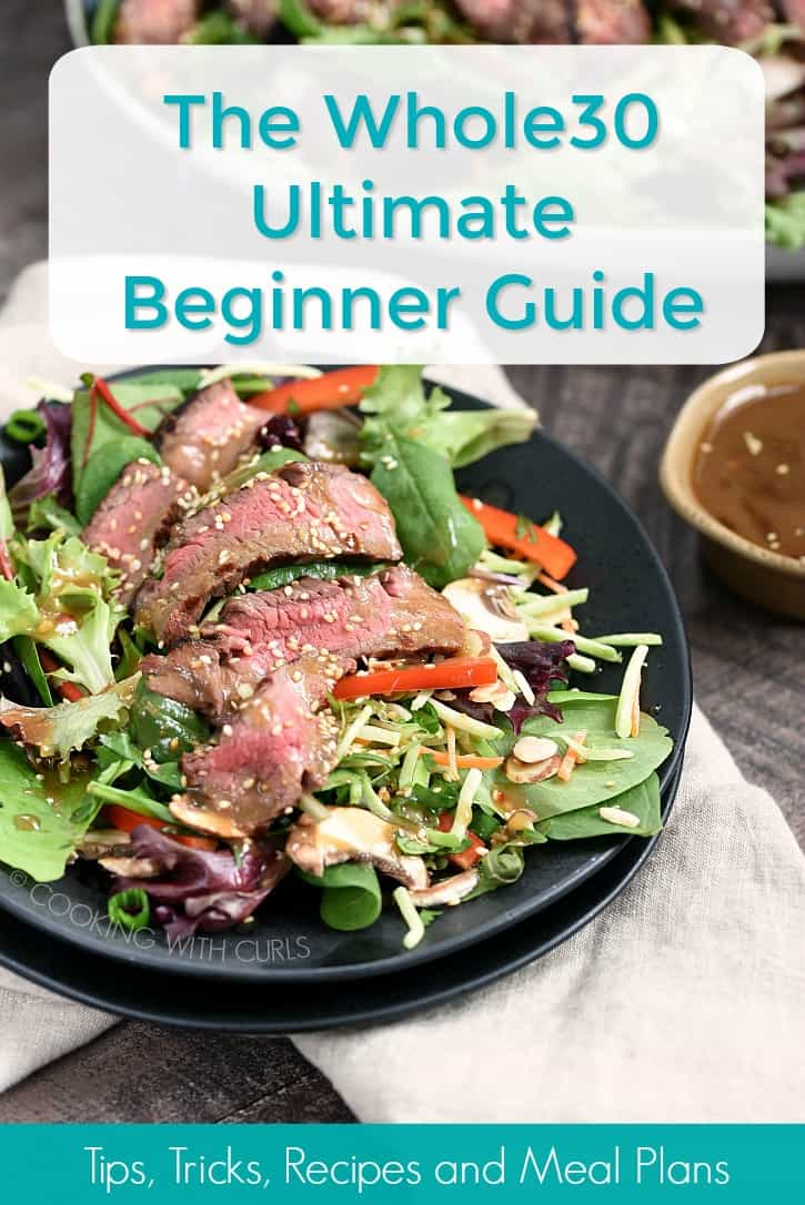 A black plate topped with an Asian Salad with dressing in the background with a graphic title The Whole30 Ultimate Beginner Guide and description