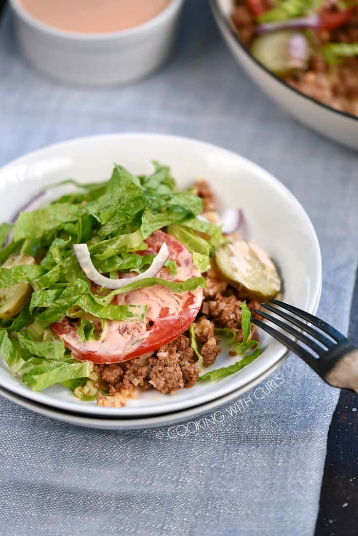 Healthy Hamburger Skillet in a white bowl with a black fork resting on the side.