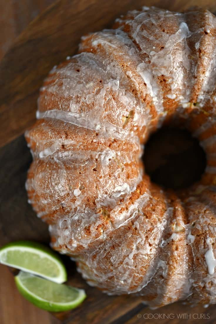 Looking down on a Margarita Bundt Cake with lime slices on the side.