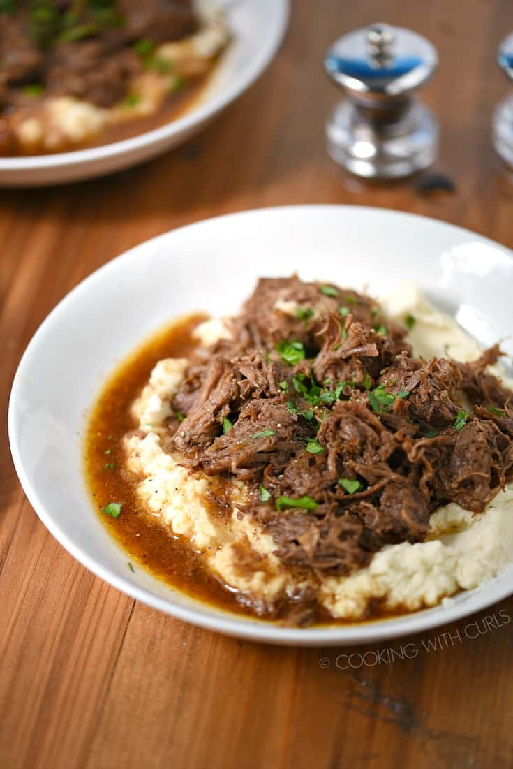 Instant Pot Cafe Mocha Pot Roast served over mashed cauliflower in a white bowl.