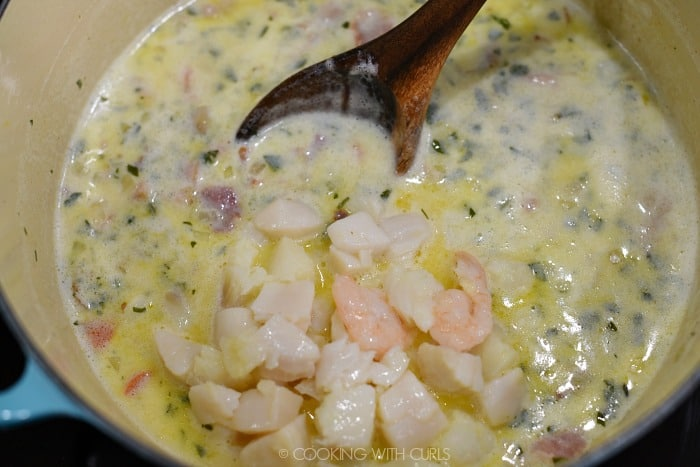 Cooked seafood added back into the large pan.