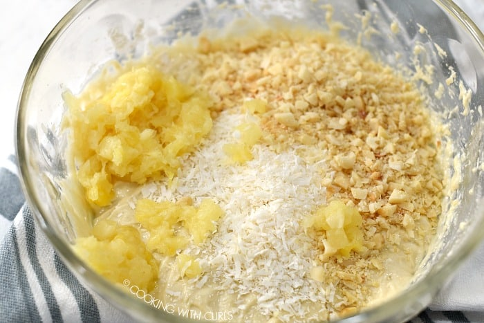Pineapple, coconut, and macadamia nuts added to the muffin batter.
