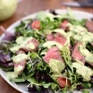 Cilantro-Lime Steak Salad with Cilantro-Lime Dressing on a white plate.