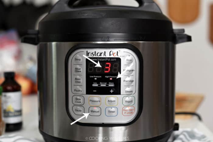looking at the face of an Instant Pot with white arrows pointing to Manual High Pressure for 3 minutes.