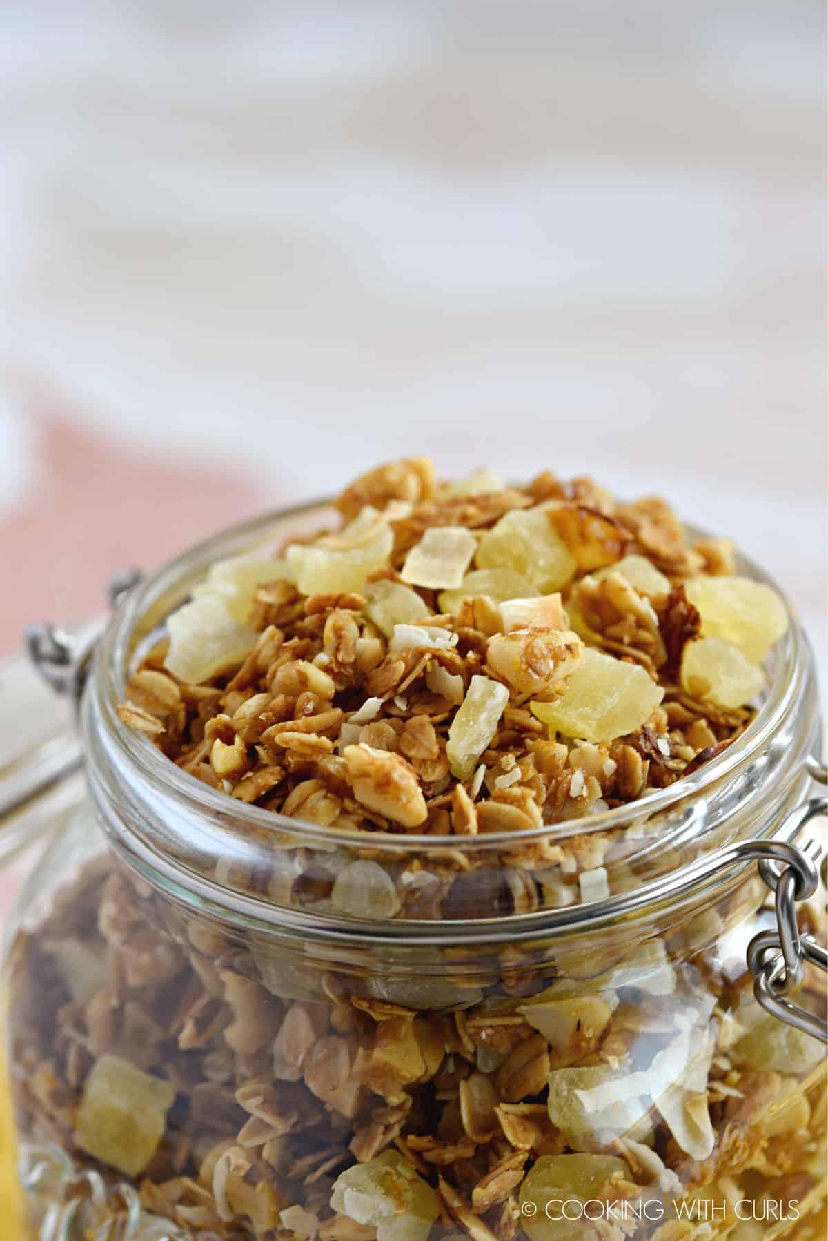 a close up image of Pina Colada Granola in a mason jar.