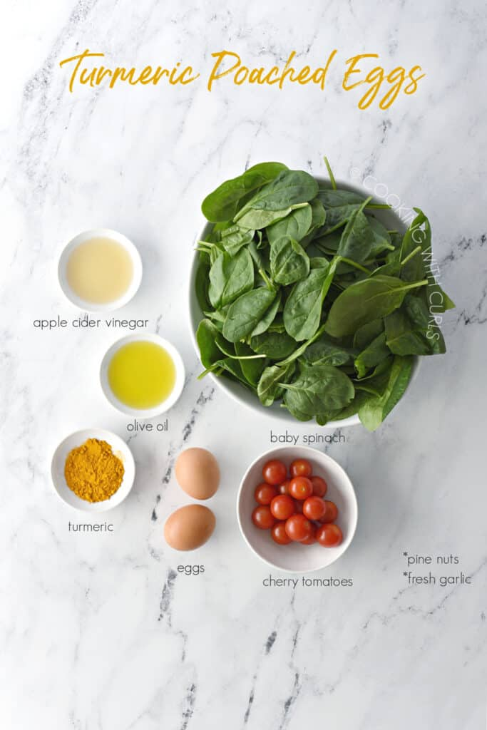 Turmeric Poached Eggs ingredients image with vinegar, oil, turmeric, eggs, tomatoes and spinach.