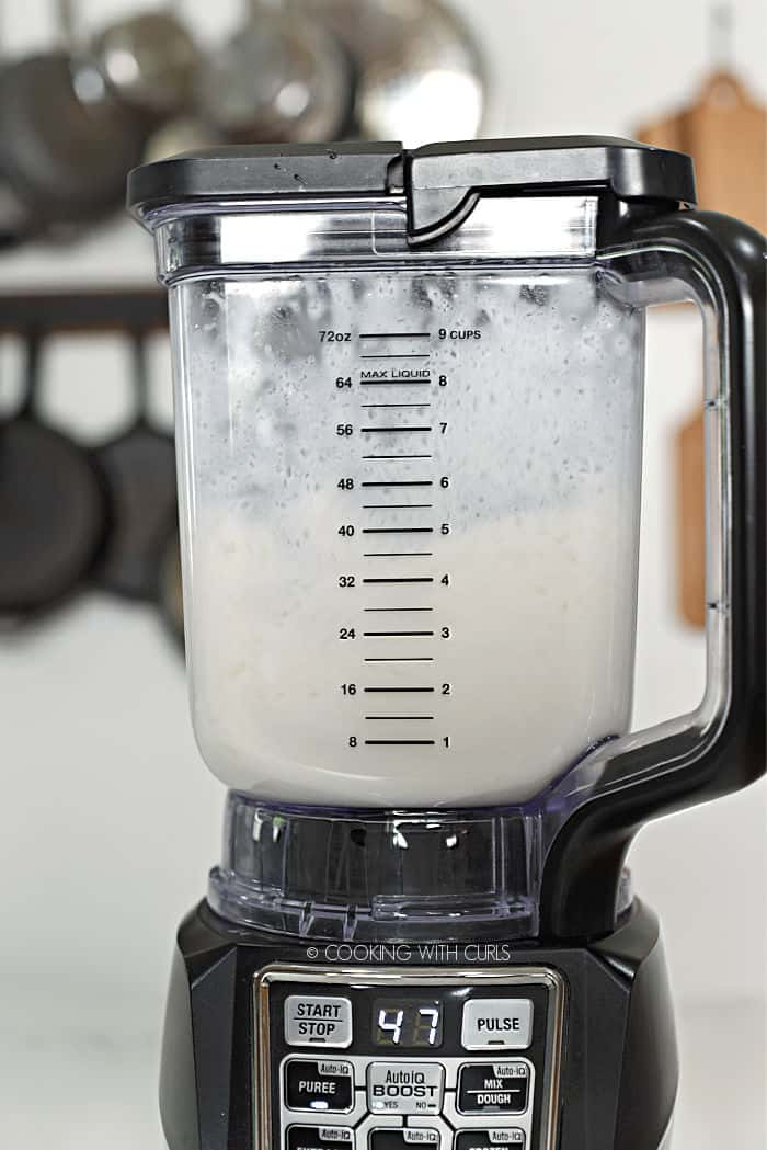 keto pina colada being pureed in a blender.