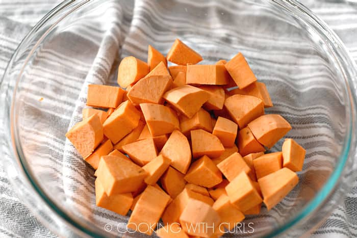 sweet yam cubes in a clear glass bowl.