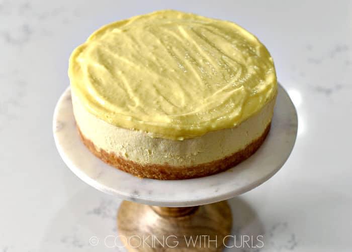 Lemon curd topped Instant Pot Lemon Cheesecake.