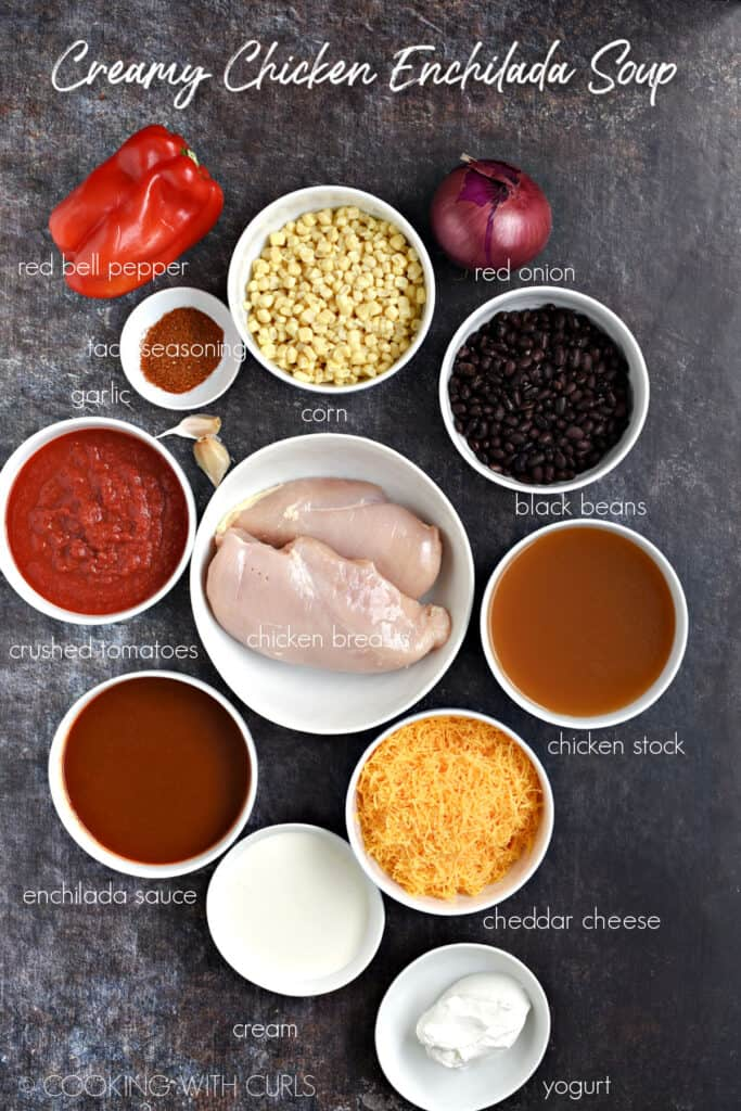 Looking down on all the ingredients for this soup in white bowls.
