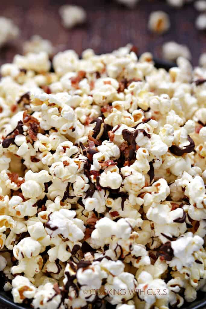 A close-up image of Instant Pot Chocolate Bacon Popcorn in a dark blue bowl.