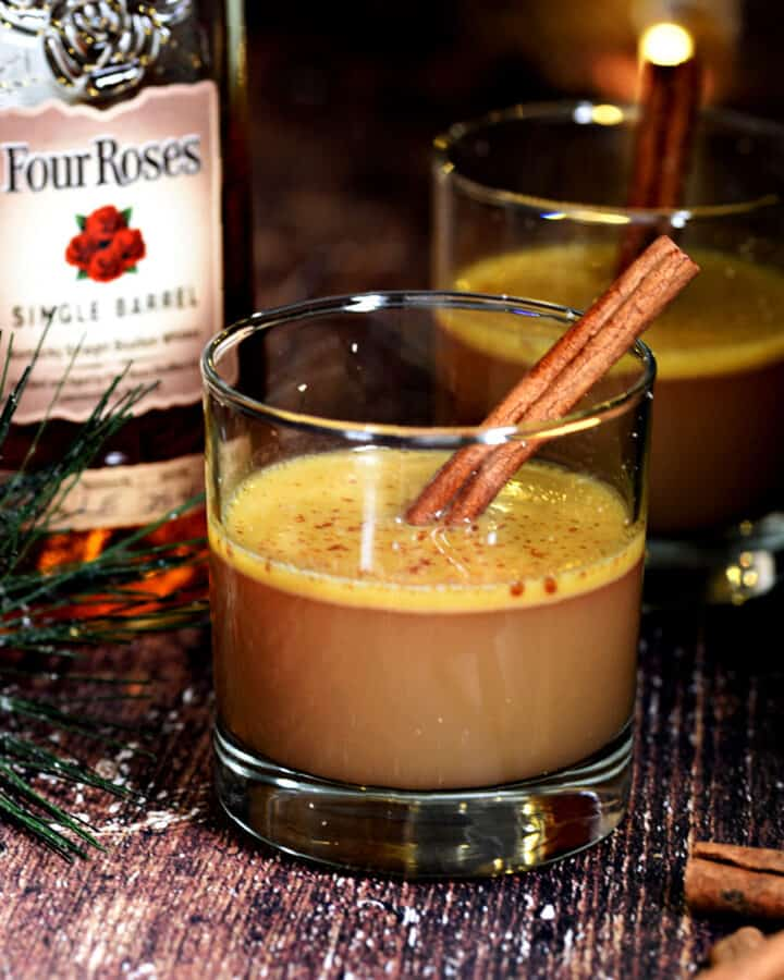 Hot Buttered Bourbon with apple cider, cinnamon sticks and nutmeg.
