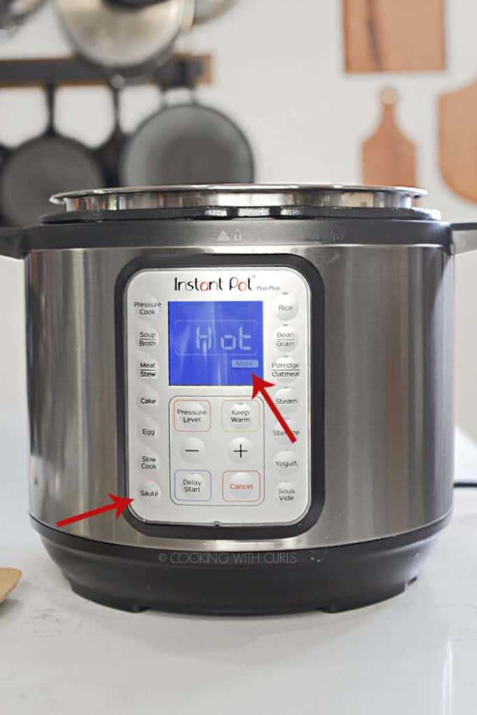 Instant Pot set to Sauté - More with red arrows pointing to each setting.