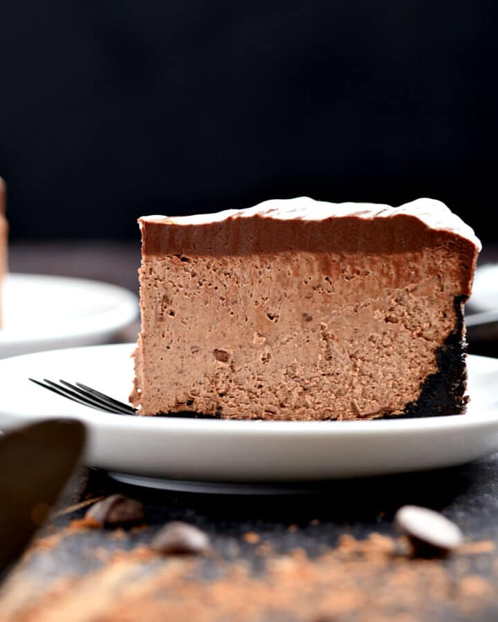 A slice of Instant Pot Chocolate Cheesecake on a white plate.