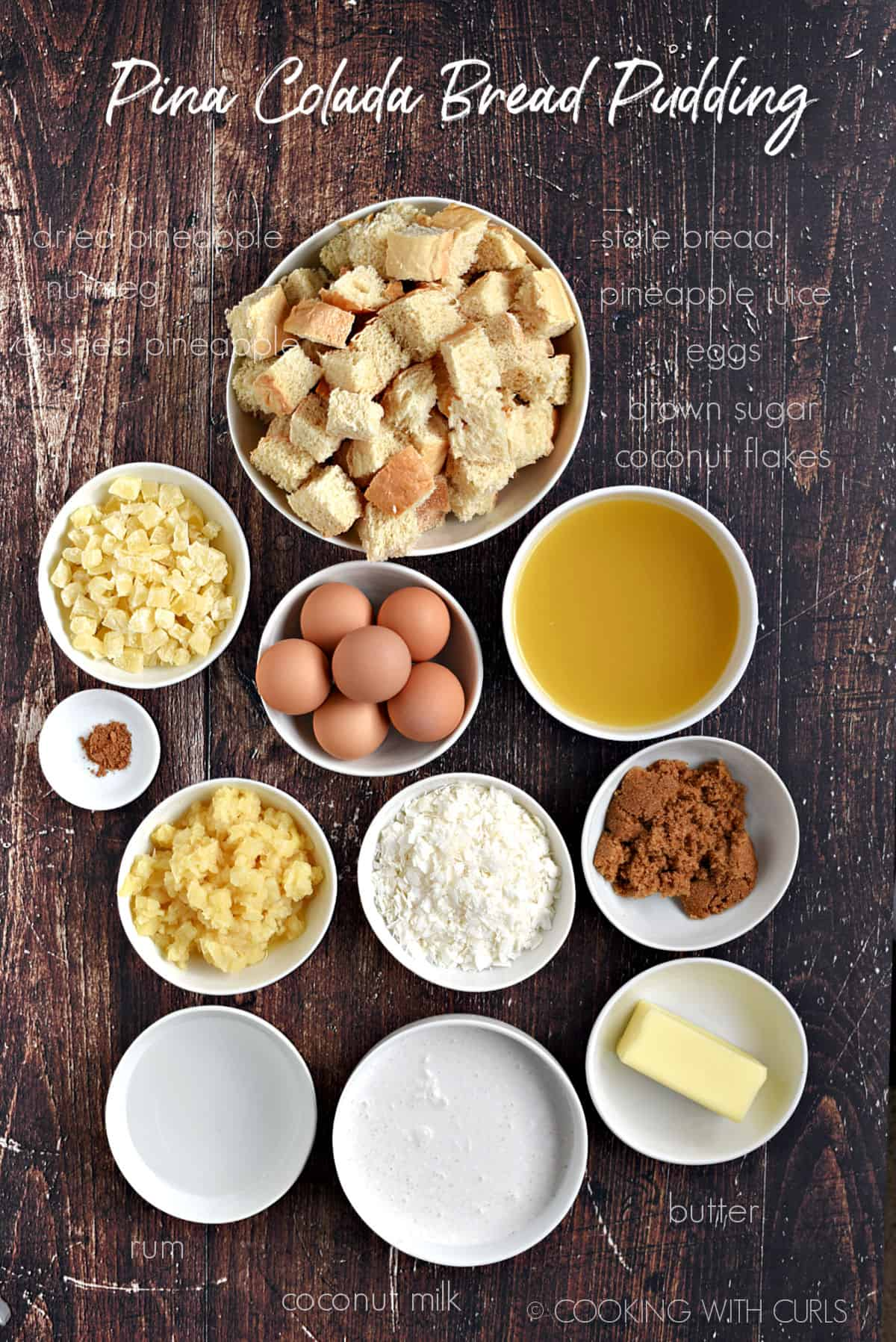 Ingredients to make Pina Colada Bread Pudding all in separate white bowls.