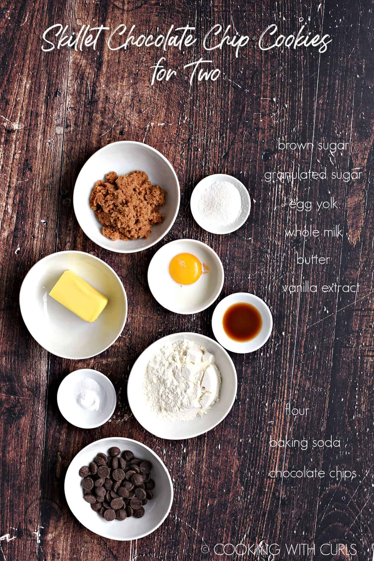 Ingredients to make Skillet Chocolate Chip Cookies for Two in white bowls.