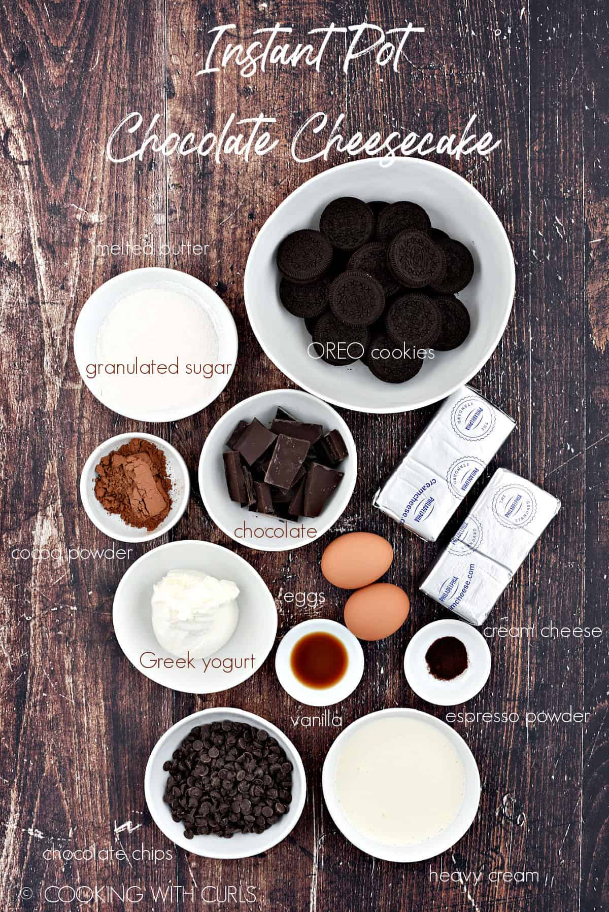 Instant Pot Chocolate Cheesecake ingredients in white bowls on a wooden background.
