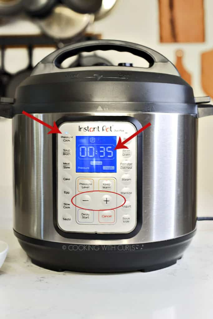 Instant Pot set for 35 minutes on HIGH pressure with red arrows to show important buttons, and a circle around the + and - buttons.