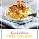 A scoop of pina colada bread pudding on a small white plate with coconut cream glaze drizzled down and a pan of bread pudding in the background with title graphic across the bottom.