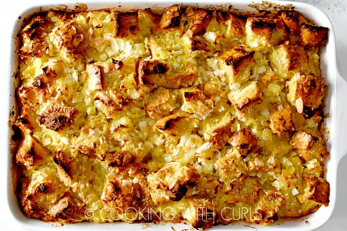 Pina Colada Bread Pudding in a white baking dish.