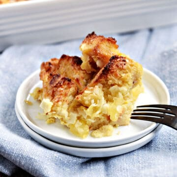 Pina Colada Bread Pudding served on a small white plate.