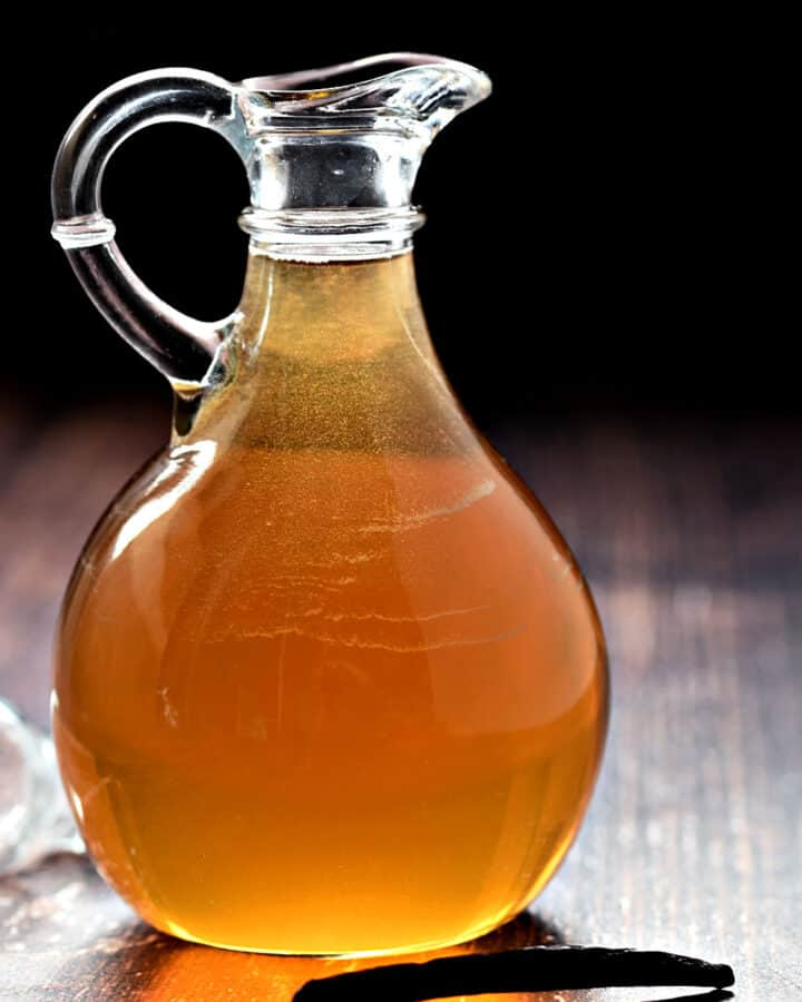 Vanilla Simple Syrup in a glass bottle with pour spout.