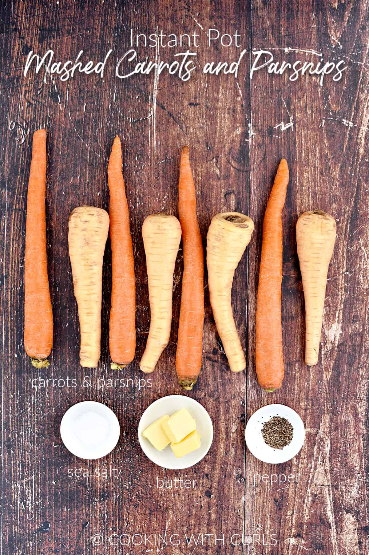 Four carrots, four parsnips, salt, butter pats and pepper in small white bowls.