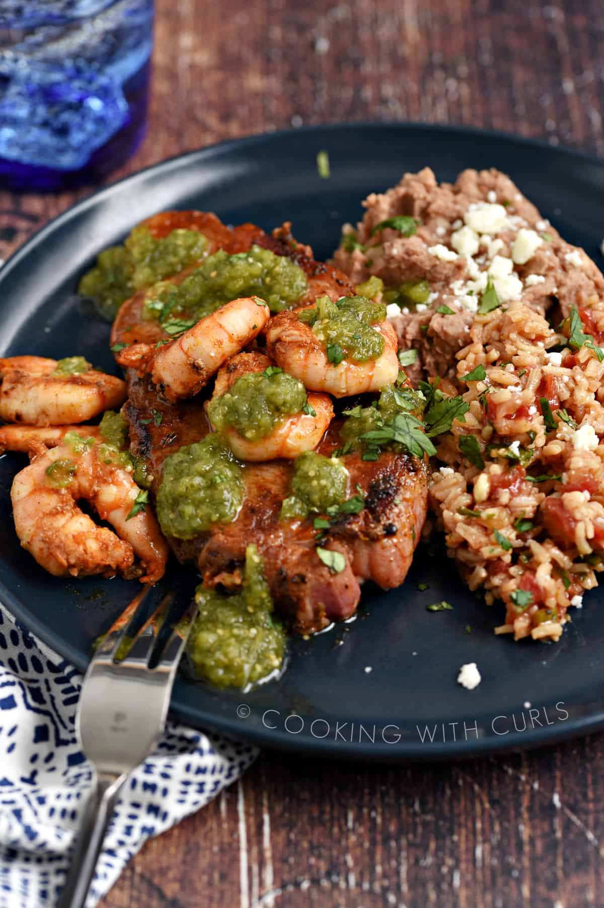 Mexican Seasoning Recipe on grilled steak and shrimp with refried beans and Spanish rice on the side.