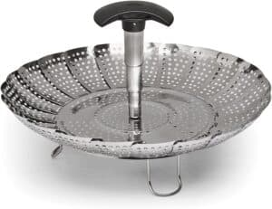 stainless steel expandable steamer with black handle.