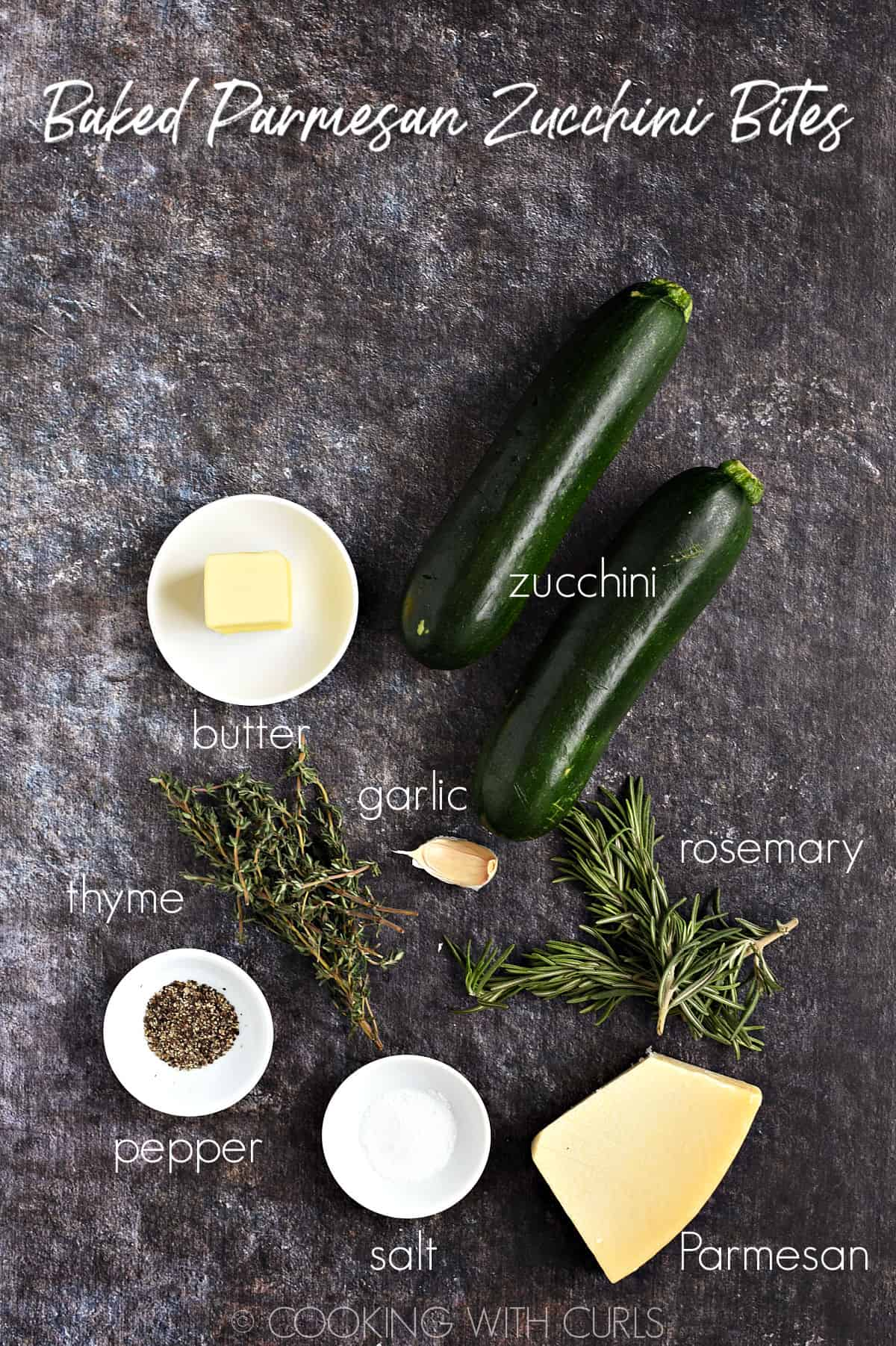 Two zucchini, butter, garlic, rosemary, thyme, Parmesan, salt and pepper on a rustic background.