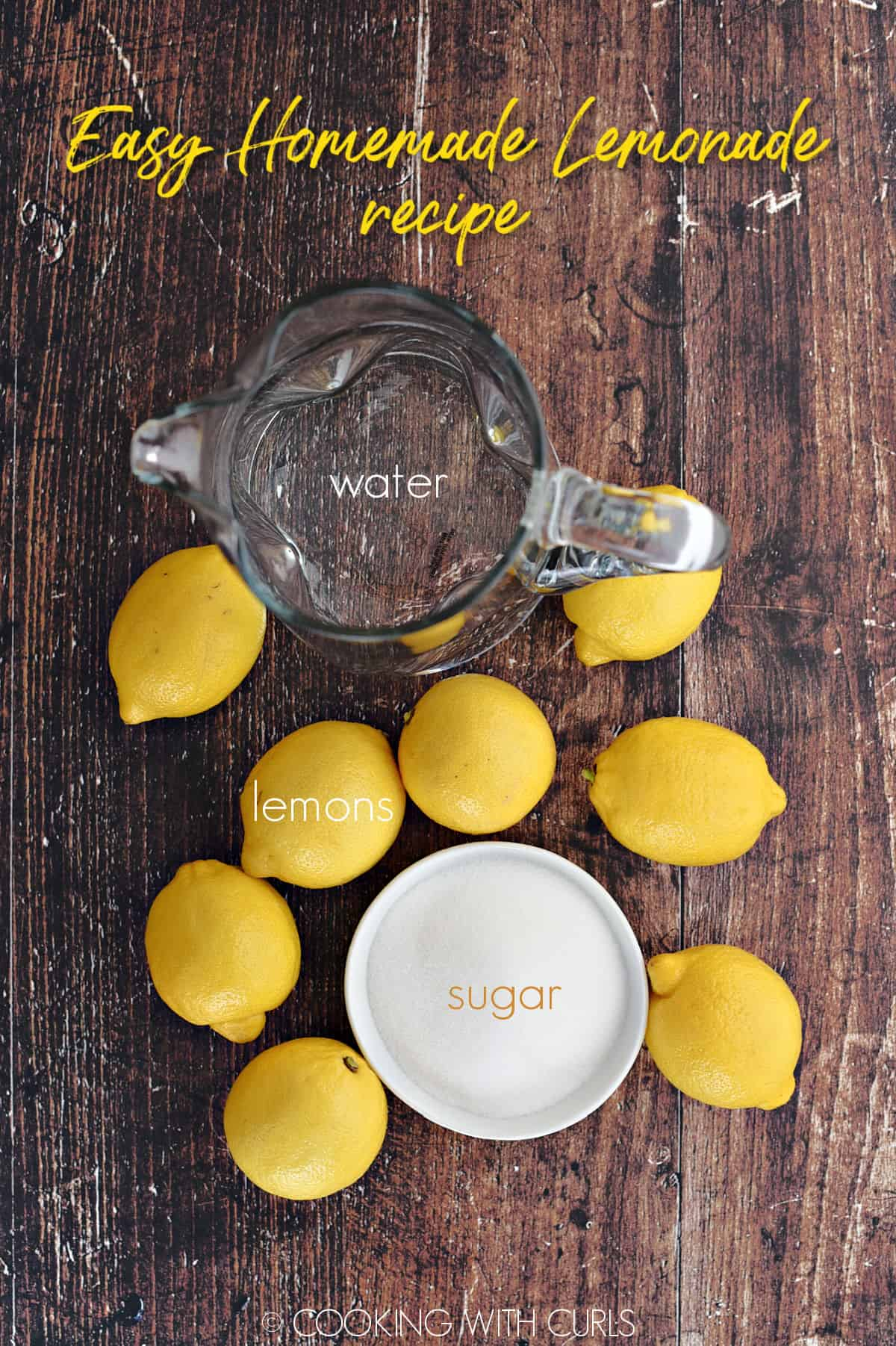 Water in a glass pitcher, 8 lemons and a bowl of sugar.